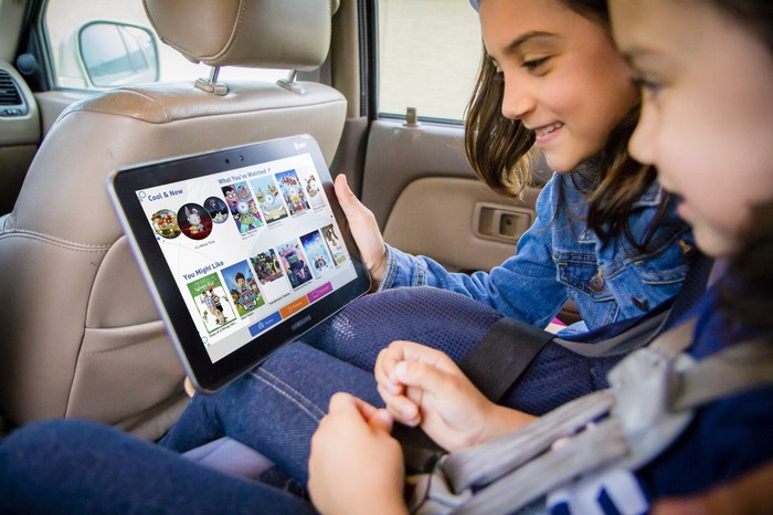 Kids using an AT&T branded tablet.