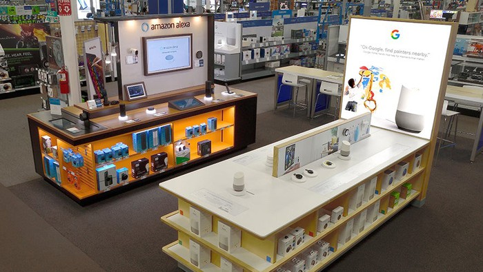 Side-by-side display cases of Amazon Echo and Google Home products.