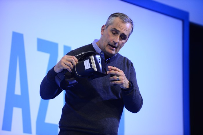 Intel CEO Brian Krzanich holding a virtual reality headset.