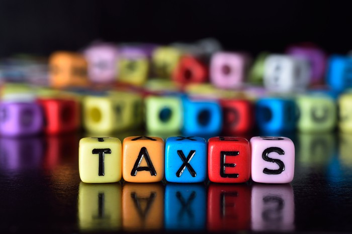 TAXES spelled on colored blocks.