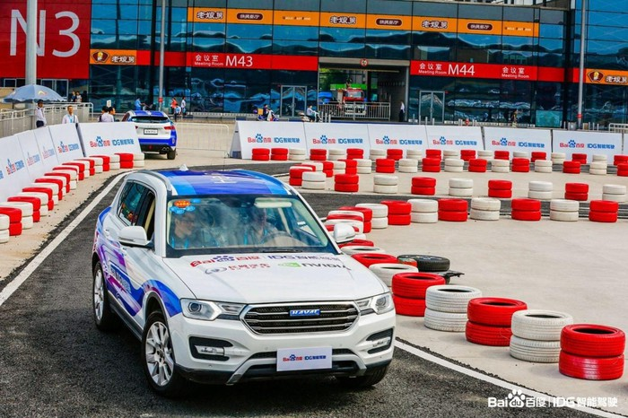 A self-driving car works its way around a track.