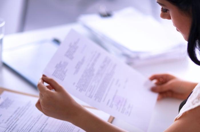 Woman looking at paperwork.