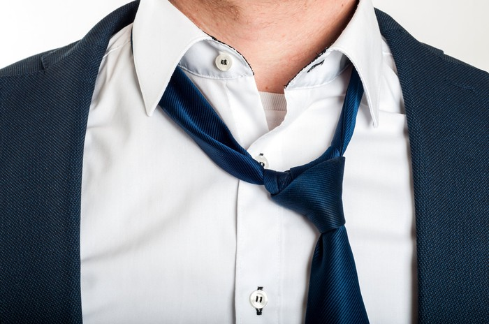 Man with loose tie and unbuttoned shirt