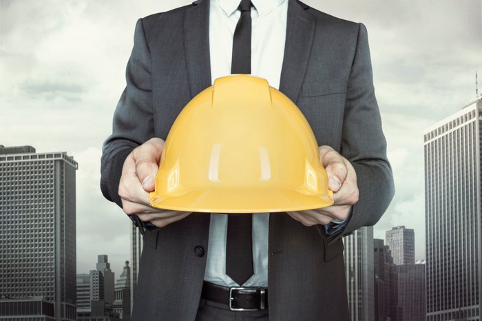 A man holding a hardhat.