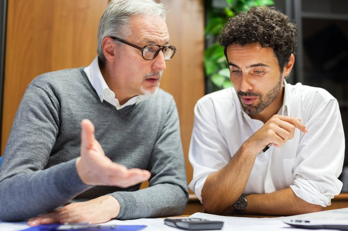 two men talking about finances