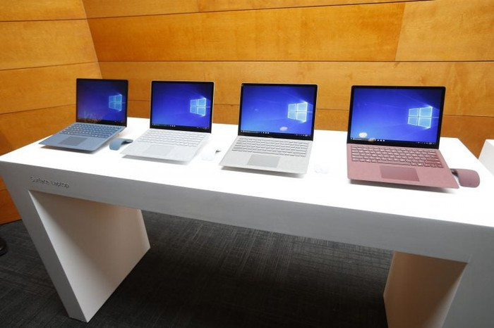 A series of Microsoft Surfaces are displayed at one of its retail stores