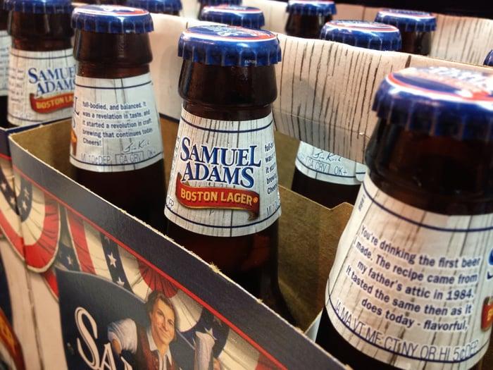 Samuel Adams beer bottles in a six-pack case.