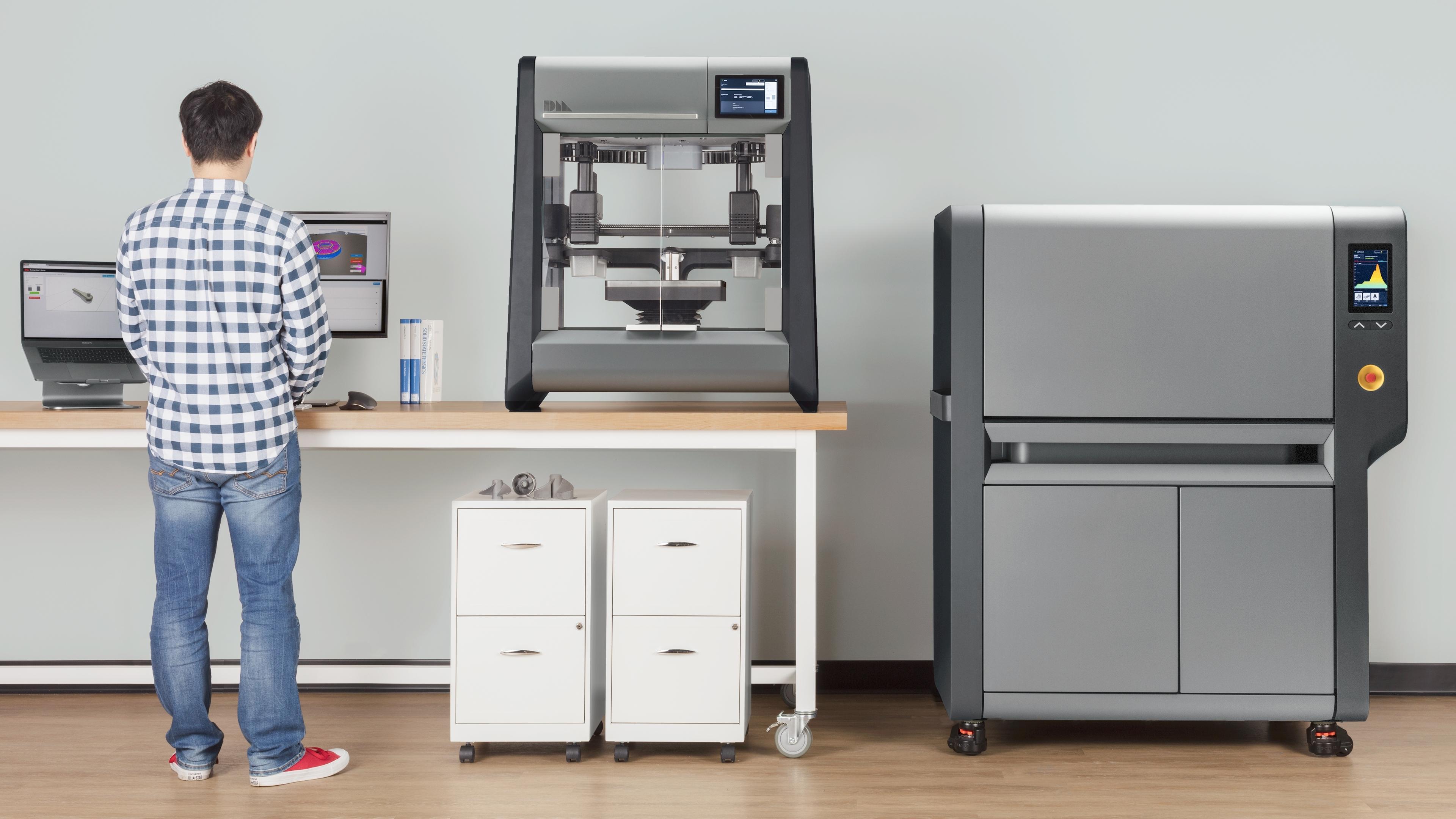 Desktop Metal's two 3D printers shown in an office.