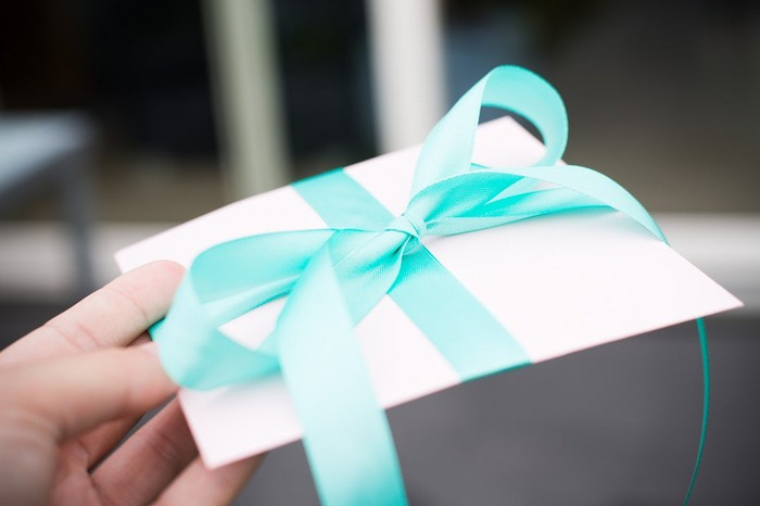 A gift card in an envelope with a ribbon
