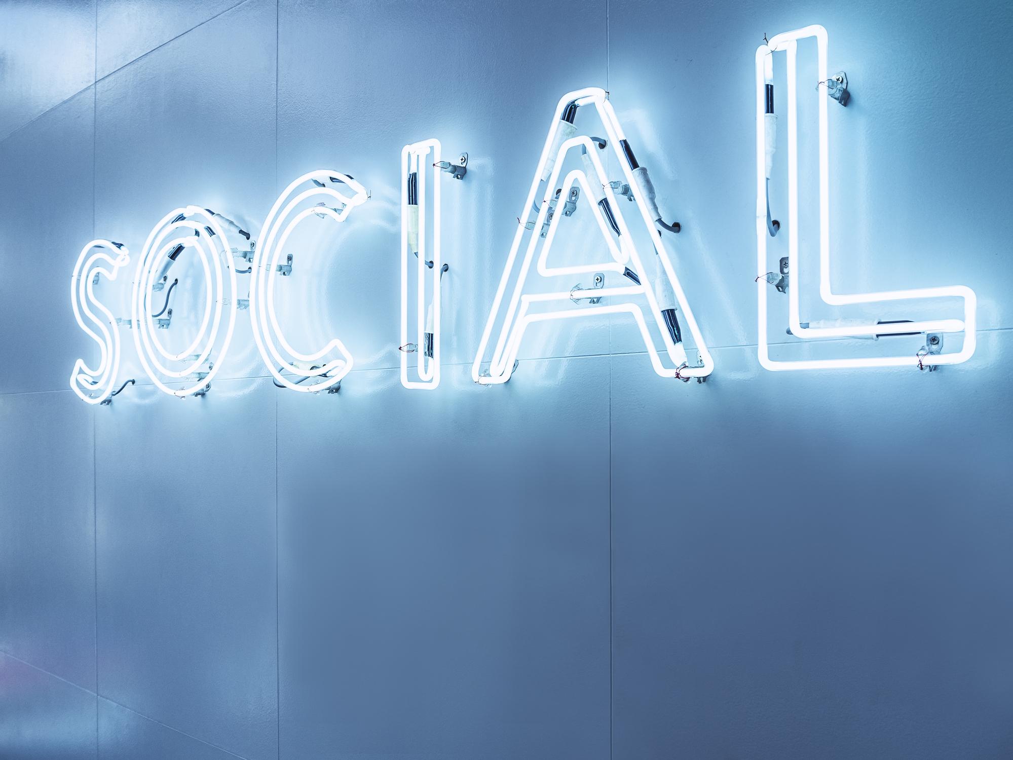 """A neon sign reading """"social"""""""
