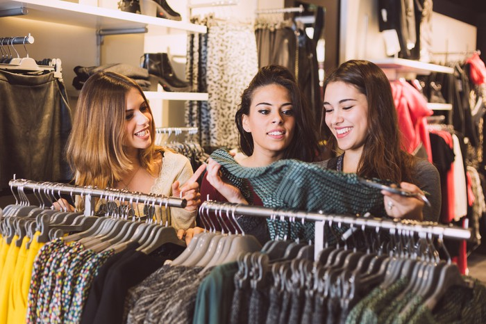 Girls shopping for clothes