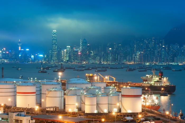 An oil tanker in the harbor of Hong Kong at night.