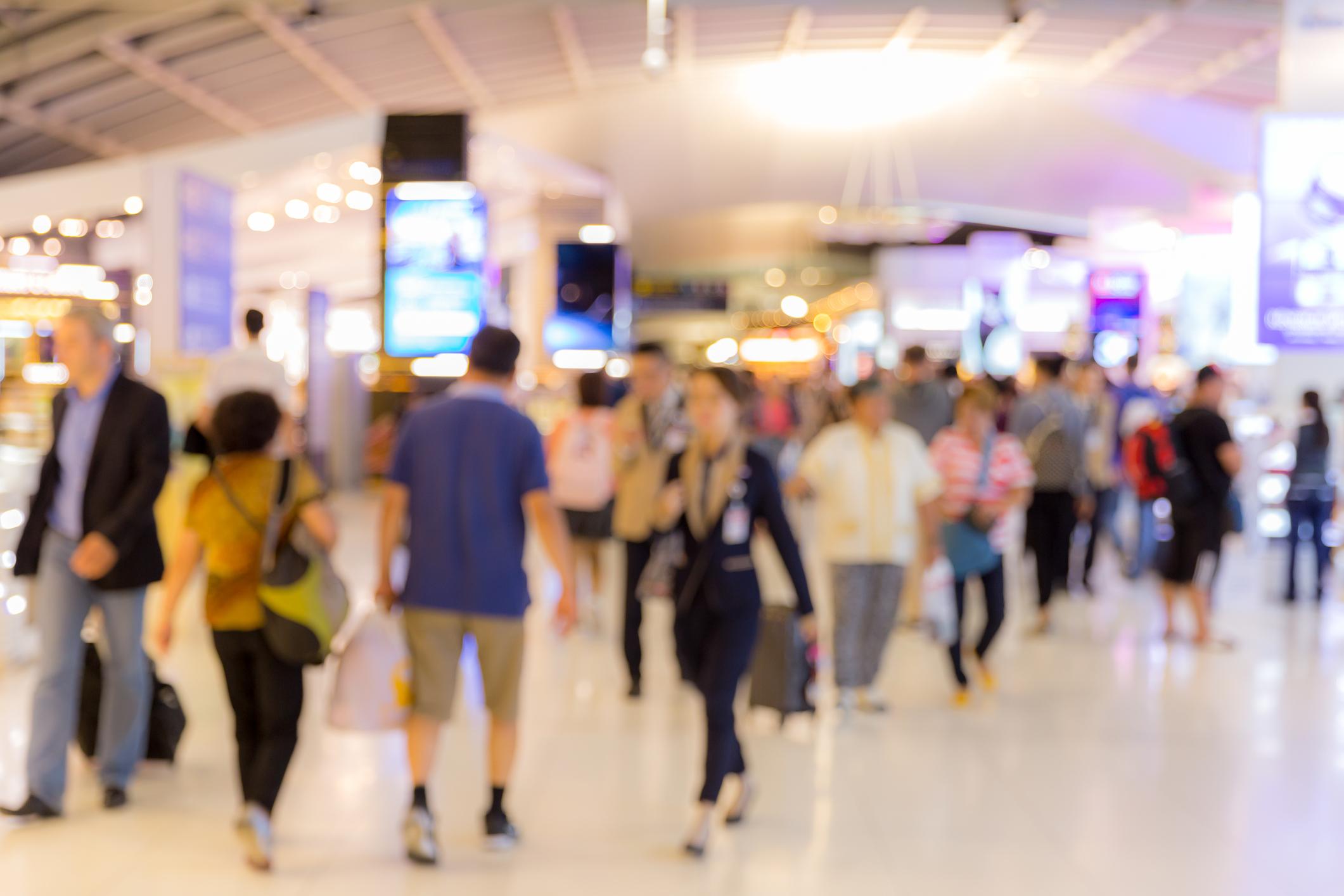 Shoppers walk through a mall.