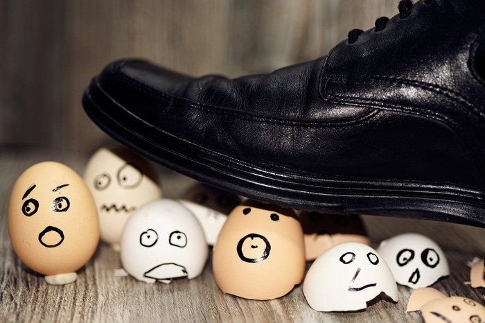 A shoe stepping on eggs