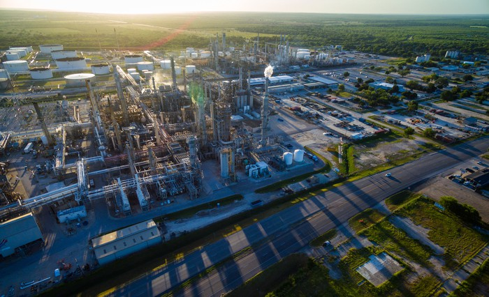 A refinery casting its shadow.