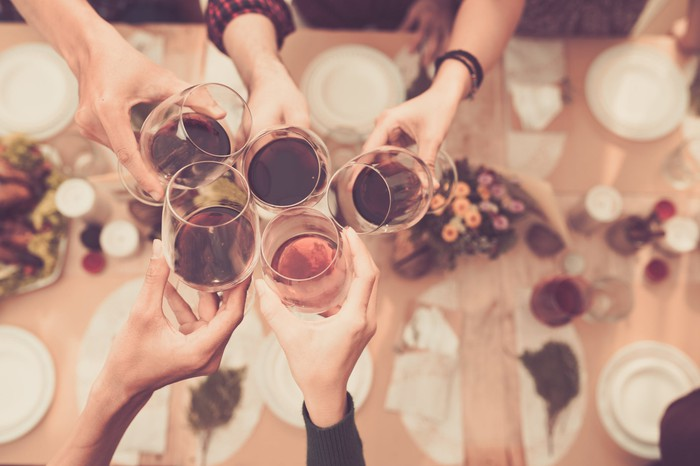 People toasting with wine and liquor