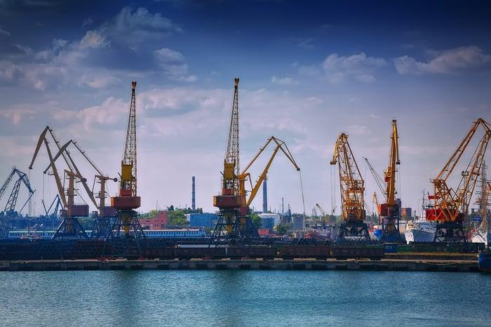 Cranes operating at a sea port.