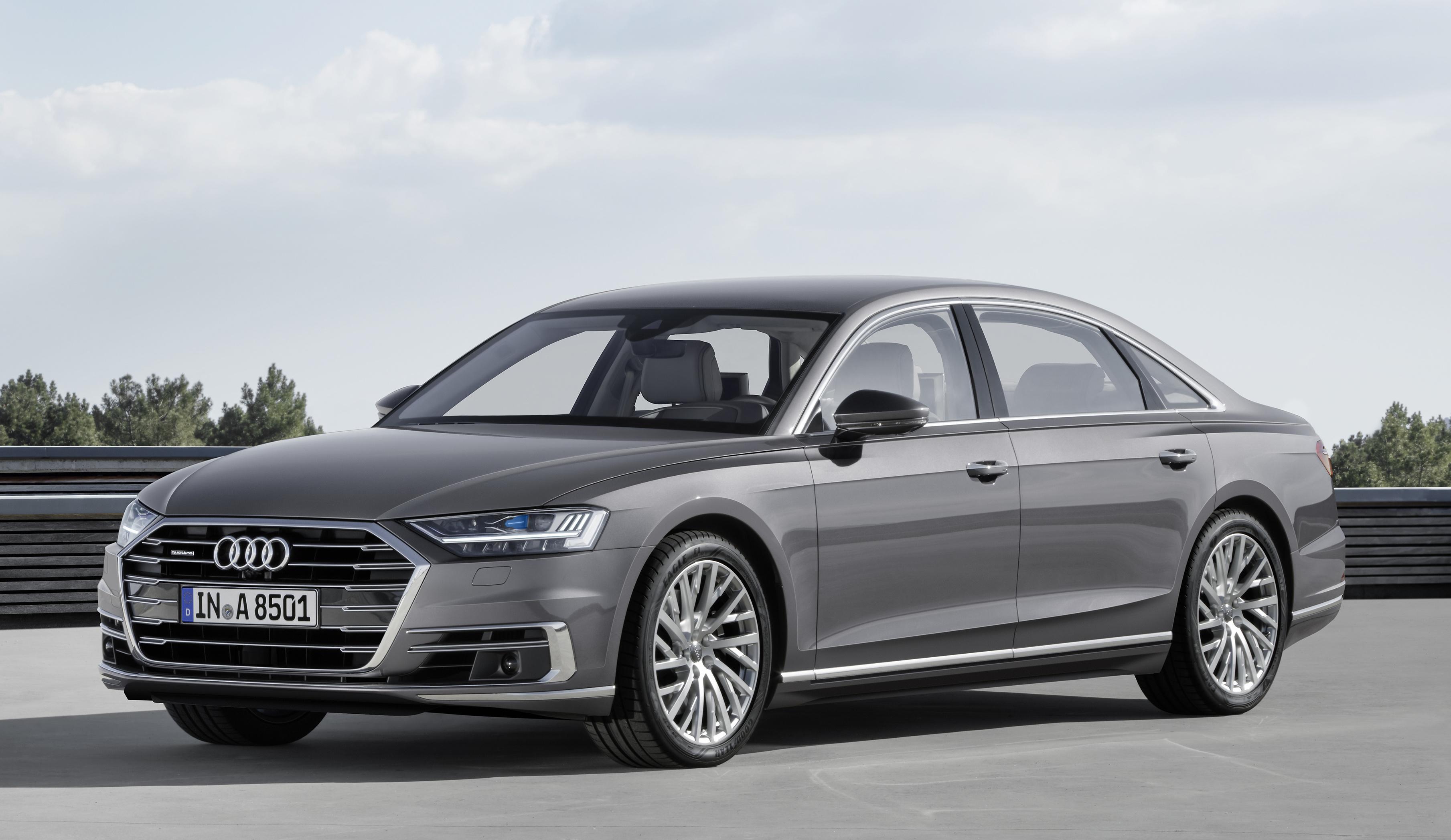 A 2018 Audi A8 sedan in silver.