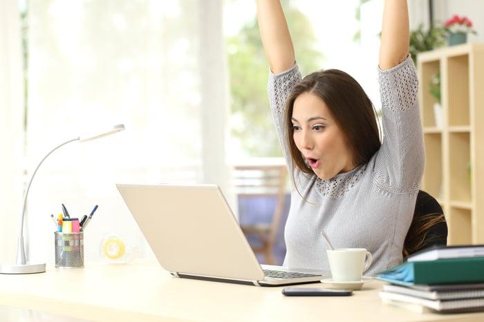 Woman winning online auction
