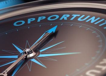 Compass with needle pointing the word opportunity.