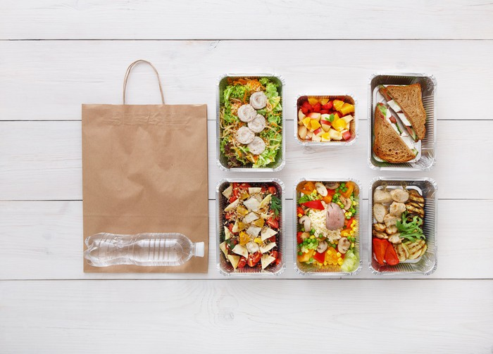 Pre-packaged meals with a bag on the floor.