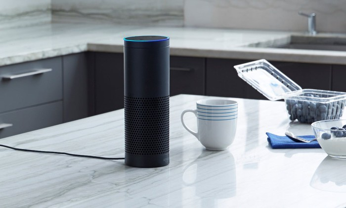 Amazon Echo sitting on kitchen countertop.