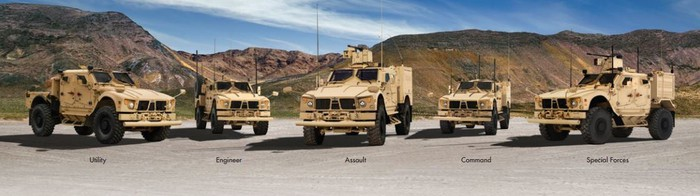A line-up of Oshkosh military trucks.