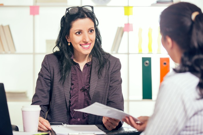 Woman meeting with a career counselor