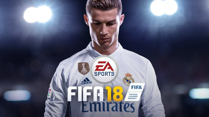 Game box art of real-life soccer player wearing uniform, stadium lights in the background, with the title FIFA 18 centered in the middle.