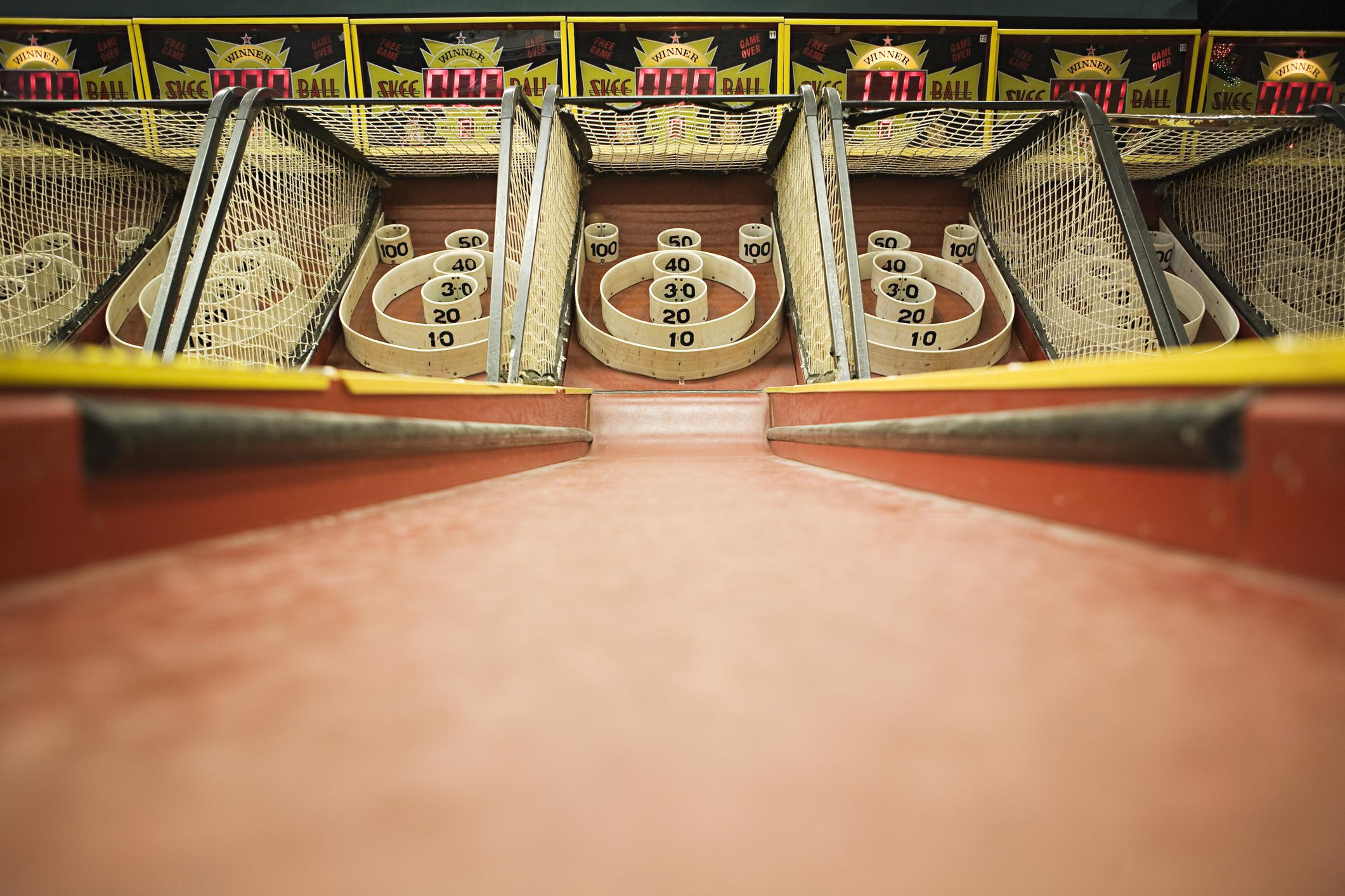 Skee ball game at an arcade.