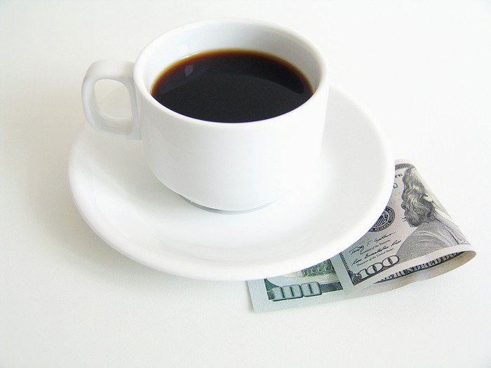 Coffee cup with a $100 bill
