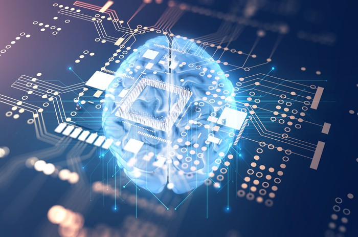 Rendering of human brain on top of a computer chip background.