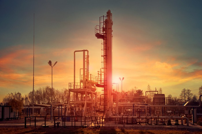 Gas compression equipment at sunset.