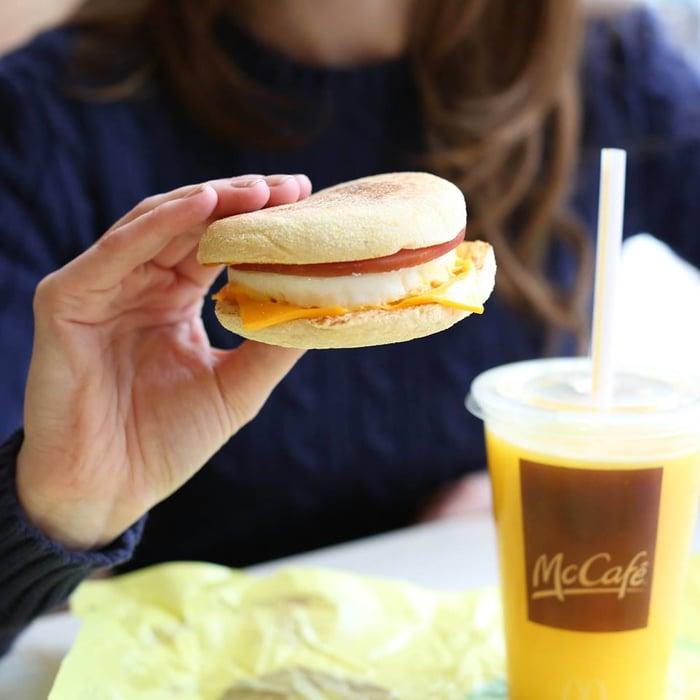 A guest enjoying a breakfast sandwich.