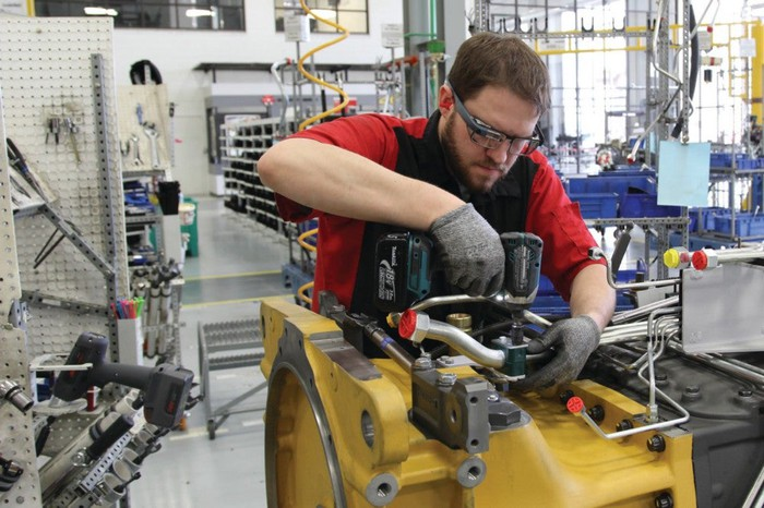 Man working in factory wearing Google Glass.