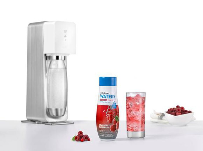 A sodastream machine with sparkling water flavoring.