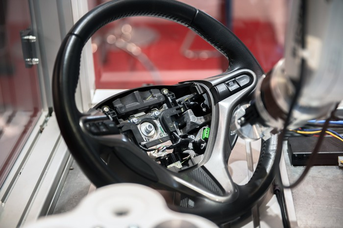 A robotic arm building a car steering wheel.