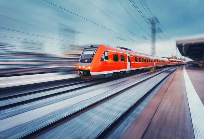A high-speed train zooming down the track