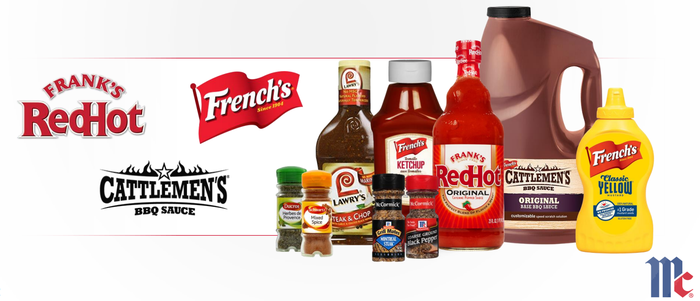 Condiments including French's Mustard, Frank's RedHot Sauce, and Catlleman's BBQ Sauce in containers.