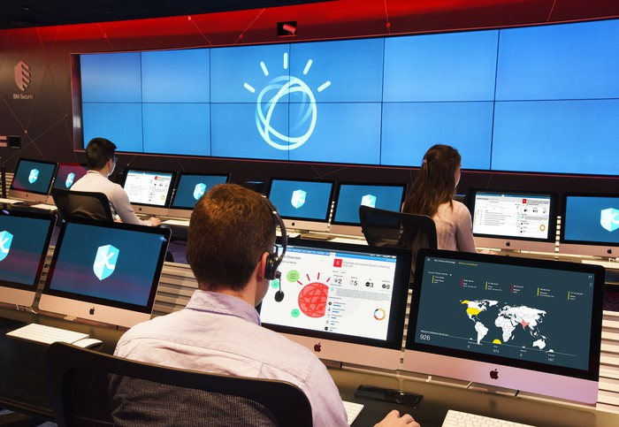 Security analysts at IBM's X-Force Command Center using Watson to investigate cybersecurity incidents.