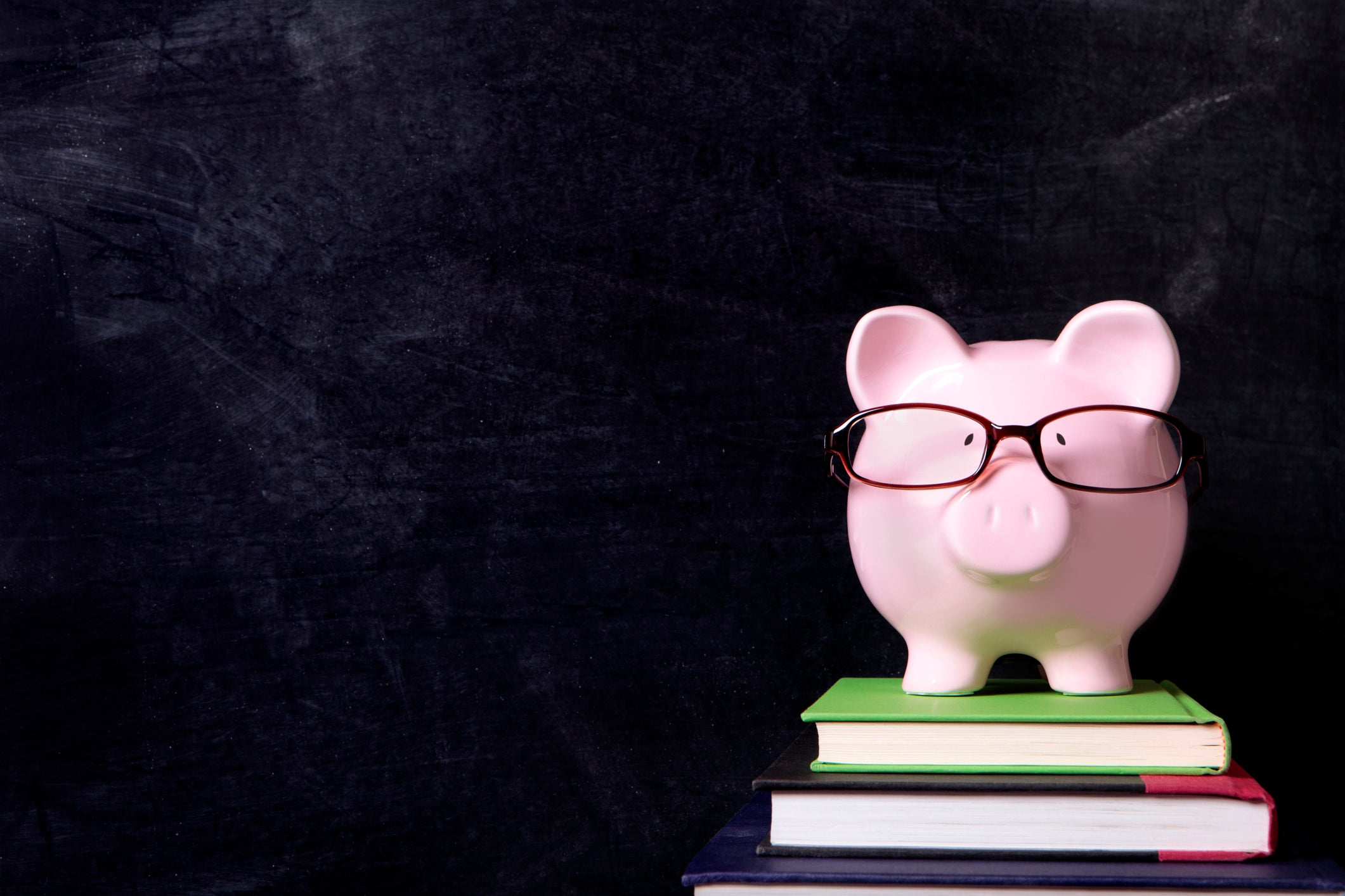 A piggy bank with glasses on.