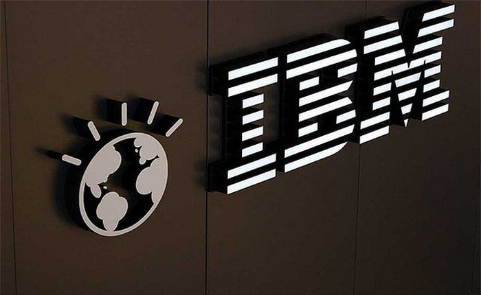 The classic IBM logo on a dark-colored wall.