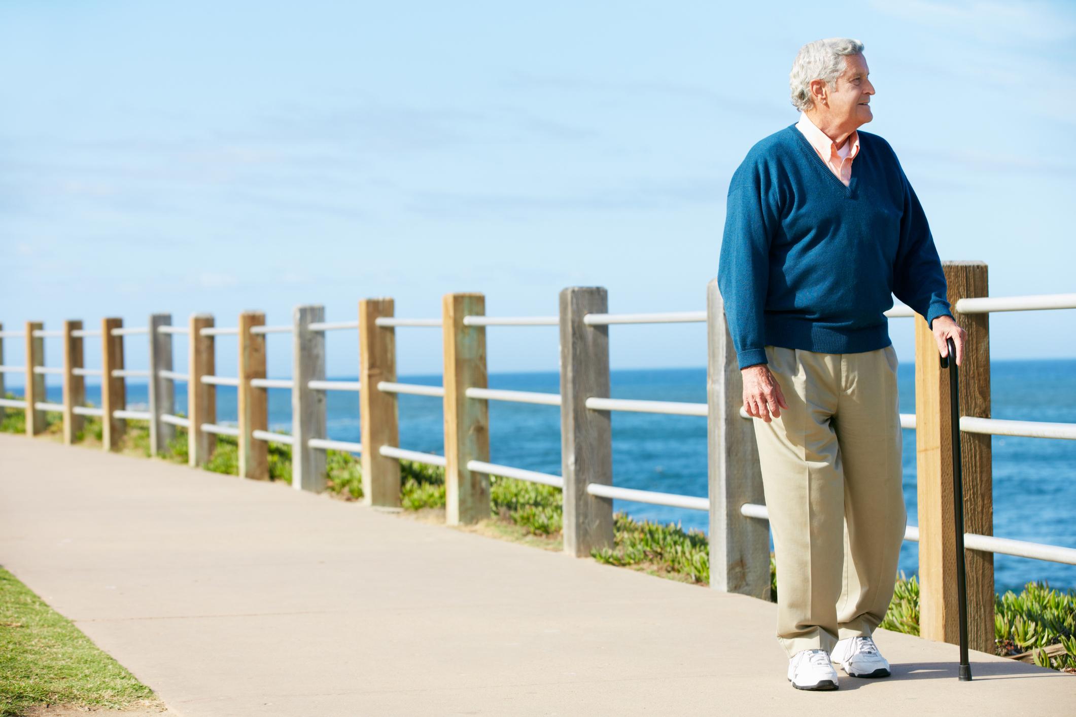 Senior man walking by the water