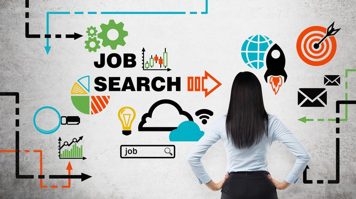 A woman looks at a diagram of a job search.