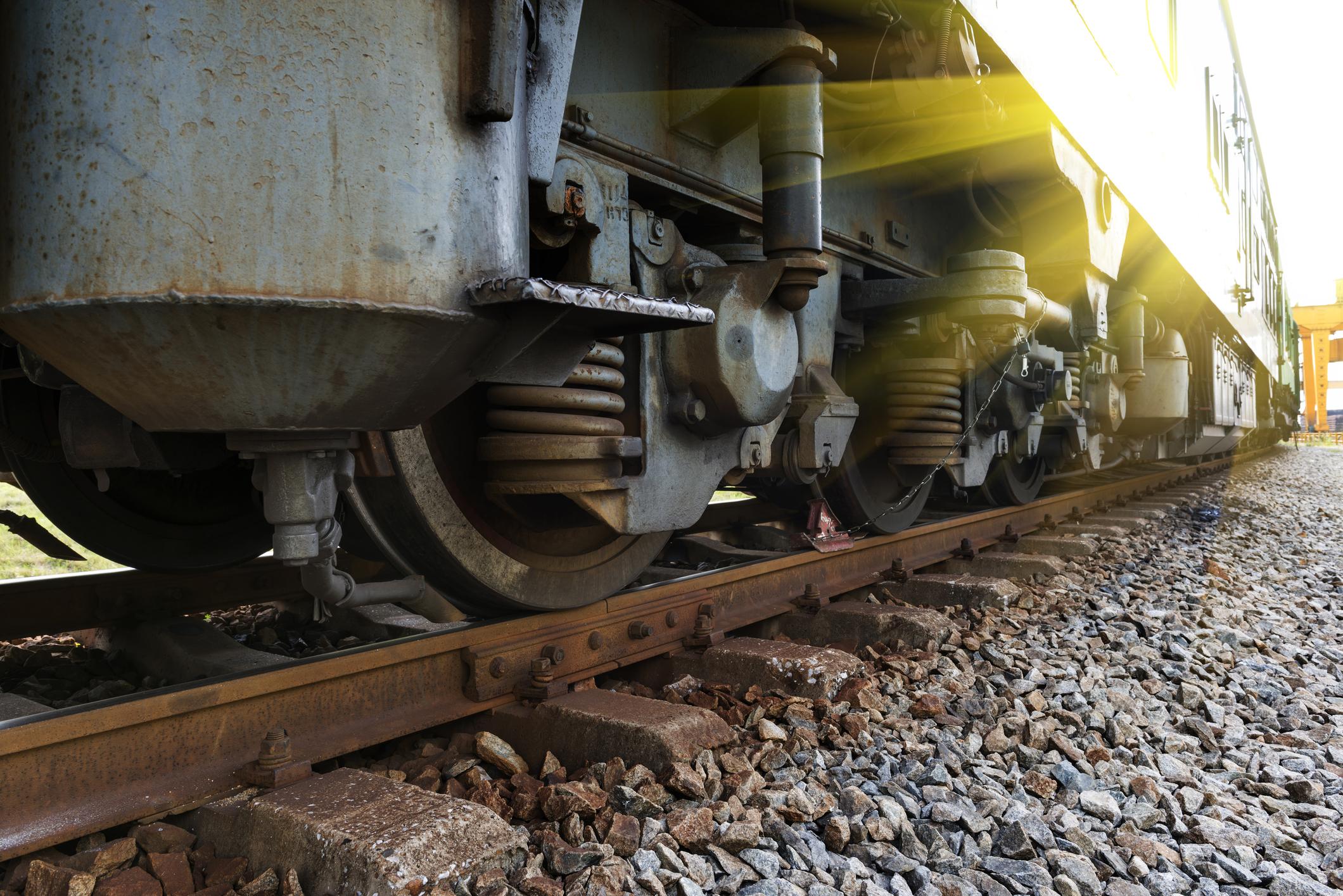 Train wheel on a track.