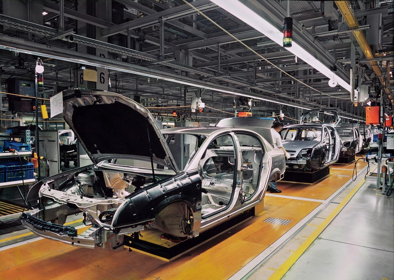 Steel car frames in an auto plant.