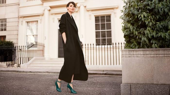 Woman modeling green high-heel shoes.