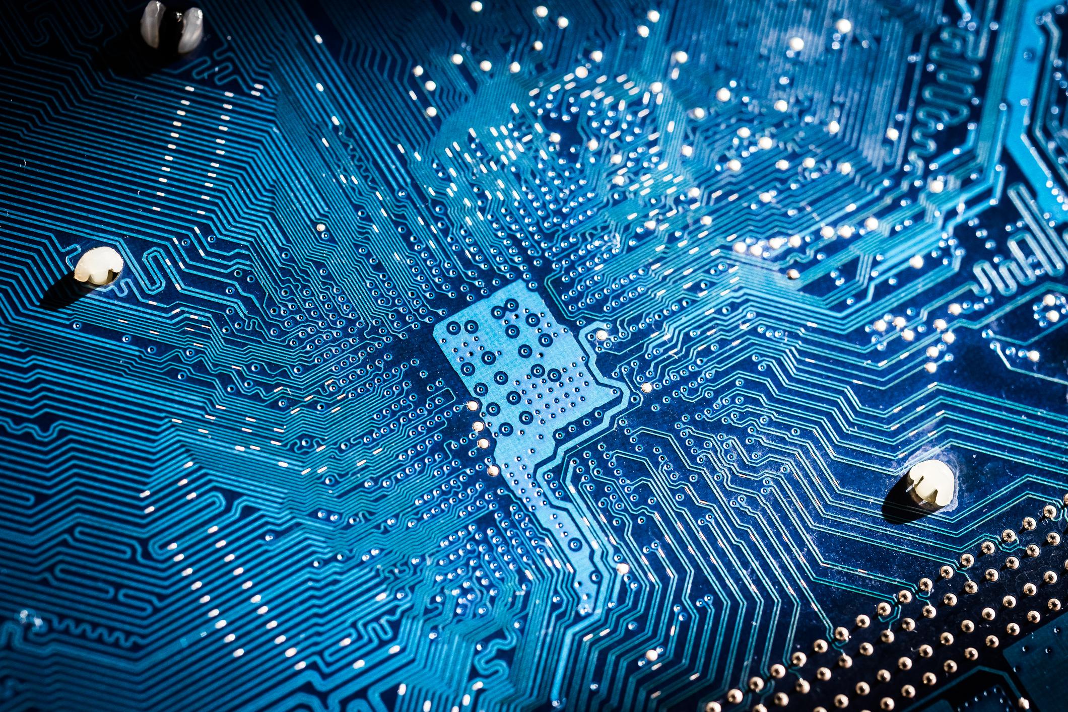 Circuit board under blue lights.