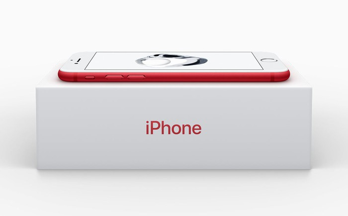Apple's iPhone in red on top of a box.