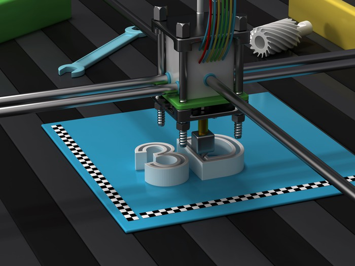 "A 3D printer printing the letters ""3D."""